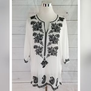 Embroidered johnny was style botique tunic top.